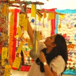 Putting up wishes on the Wishing Tree installation which was put up at  Kala Ghoda Fair.